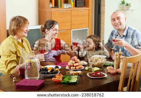 happy multigeneration family communicate around festive table