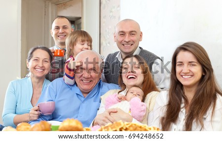 happy multigeneration family with little children at home