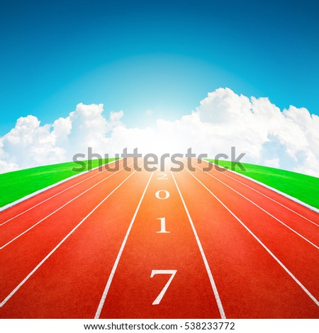 2017 Happy New Year, athletics sport running track concept with blue sky and clouds