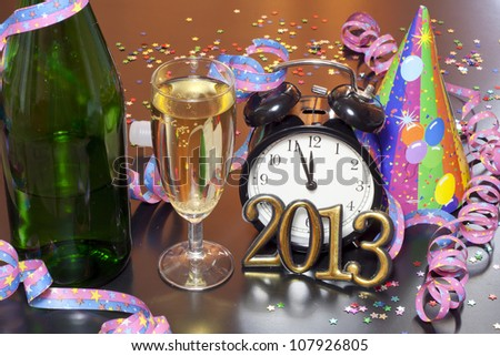 2013 happy new year party with clock champagne and hat on table