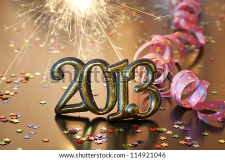 2013 happy new year party with serpentine and sparklers - stock photo