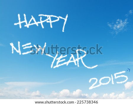 """happy new year 2015"" written in the sky with contrails left by airplane - stock photo"