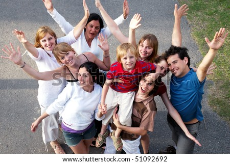 happy people smiling outdoors in a park - stock photo