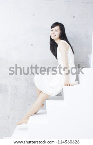 happy relaxed girl sitting on steps - stock photo