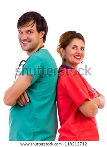 Happy team of two doctors standing back to back with arms folded isolated on white background - stock photo