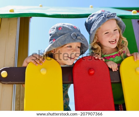 happy toddler girls on the playground