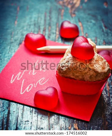 """Happy Valentines Day"" messages o with chocolate cupcake against a rusty wooden background for a stylish, fun and cheerful Valentines Day. - stock photo"