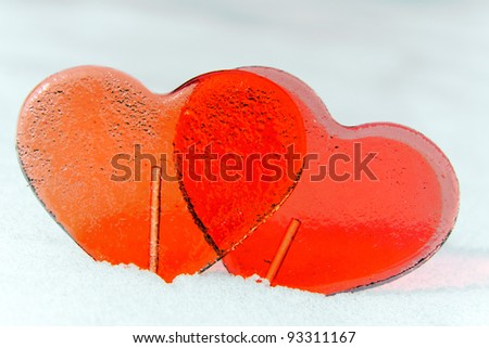 Happy Valentines with two sweet candies outdoor on snow - stock photo