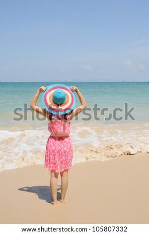 Happy Woman running on the beach in Krabi Thailand - stock photo