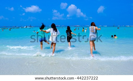 happy women enjoy in sea surf waves on beach pattaya in  thailand.