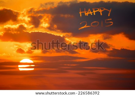 """happy 2015"" written in the sky at sunset - stock photo"