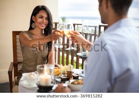 Happy young couple having romantic dinner outdoor - stock photo