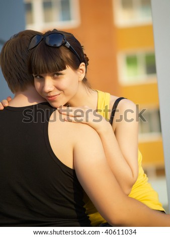 happy young couple outdoors looking directly - stock photo