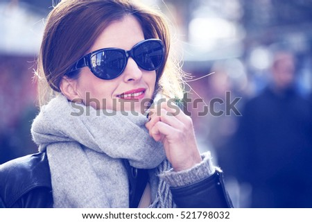happy young women walking and shopping  in city with paper bag. Trendy woman consumer looking the shop windows.