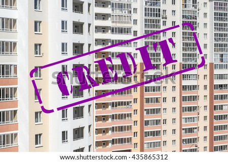 "?he stamp ""credit"" against the backdrop of houses - stock photo"