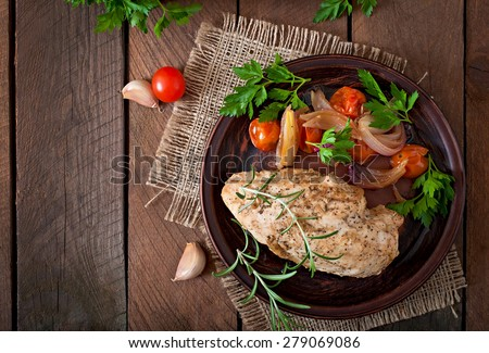 healthy dinner - healthy baked chicken breast with vegetables on a ceramic plate in a rustic style. Top view. - stock photo