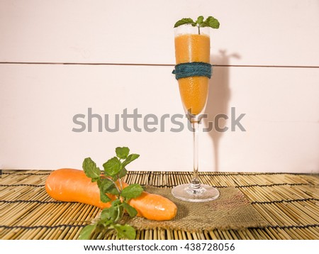healthy organic detox with carrots-pink color and wooden background - stock photo
