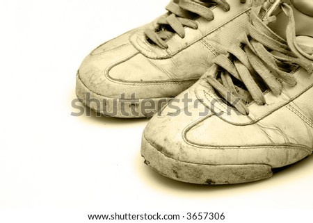 heavy used sneakers isolated on white background - stock photo