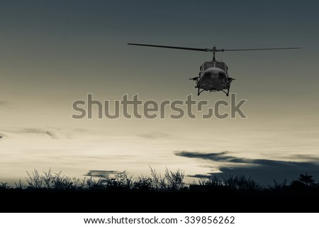 helicopter on multicolored sunset  - stock photo