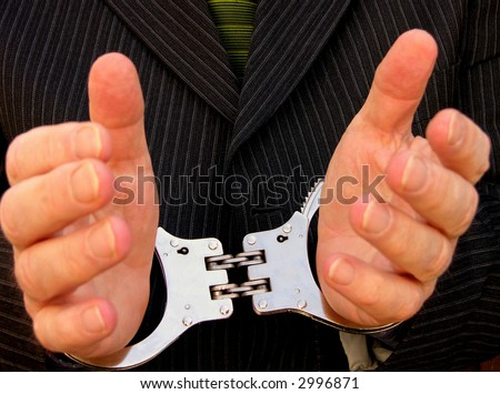 His hands are tied or locked together - stock photo