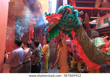 Ho Chi Minh City, Vietnam - February 22, 2016: Inside view of a Chinese temple in HCMC city. All people who arrived here with the unicorn, dragon figures, lit incense to pray for their family members