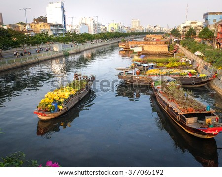 Hochiminh City, Vietnam - February 4, 2016 - the annual Lunar New Year, many boats loaded with many kinds flowers from the garden in the southwest through the canals, forming a large flower market