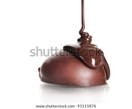 ?hocolate candy poured chocolate isolated on white - stock photo