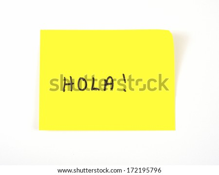 'Hola' written on a yellow sticky note (hello in Spanish) - stock photo