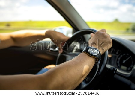 holding a steering wheel - stock photo