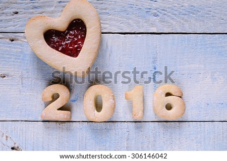 2016 homemade cookies on wooden table in the kitchen - stock photo