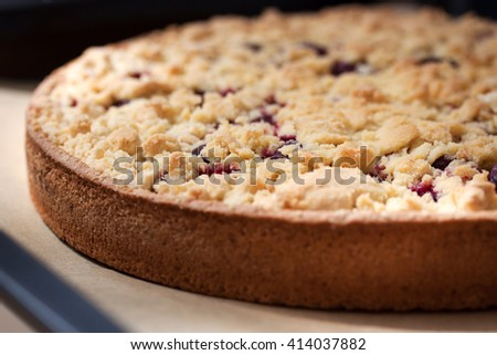 Homemade fresh sweet cherry crumble pie with whole wheat flour on kitchen background ready to bake, closeup  - stock photo