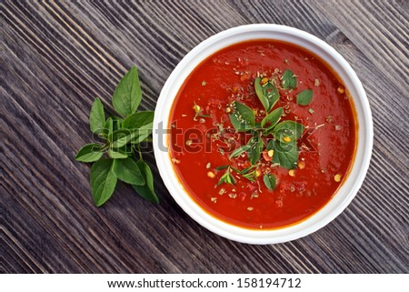 Homemade, fresh  tomato sauce in the white bowl - stock photo