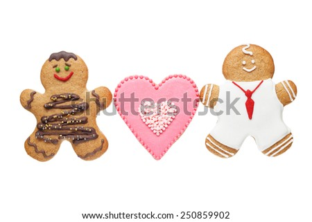 homemade gingerbread couple and cookie in shape of heart for Valentine's Day on white background. - stock photo
