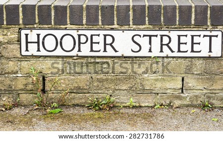 'Hooper Street'  conceptual image of a street sign Cambridge, England