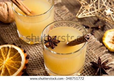Hot toddy drink (apple rum punch) for Christmas and winter holidays. - stock photo