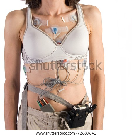 24 hour heart monitor attached to female patient - stock photo