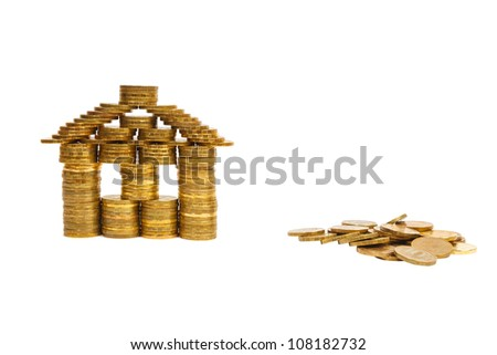 house built of coins isolated on white background - stock photo