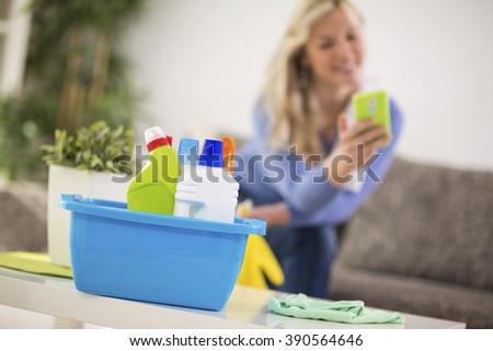 Housewife on break of cleaning - stock photo