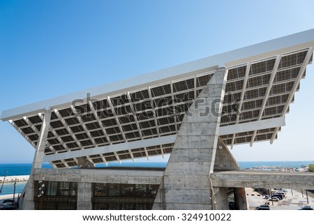 "Huge Solar Panel in the harbor ""Port Forum"" in the district Poblenou in north of Barcelona. The old industrial estate was rebuild with a new port, technology, buildings and museums - stock photo"