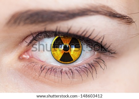 Human eye with radiation hazard symbol - concept photo.  - stock photo