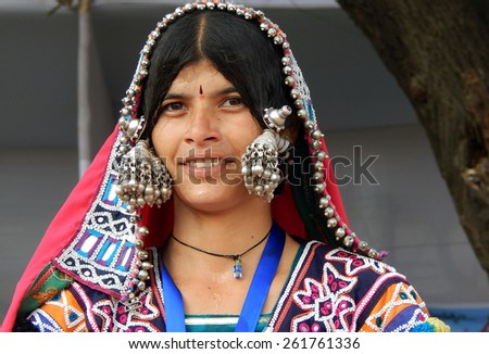 HYDERABAD,INDIA-MARCH 3:Closeup portrait of an Indian banjara woman with silver ornaments and colorful dress on March 3,2015 in Hyderabad,telangana,india.                                  - stock photo