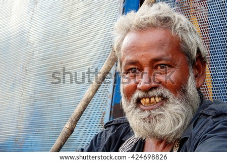 HYDERABAD,INDIA-MAY 20: portrait of Senior homeless poor Indian man seek help or alms at entrance of Hindu temple, Charminar  on May 20,2016 in Hyderabad,India.