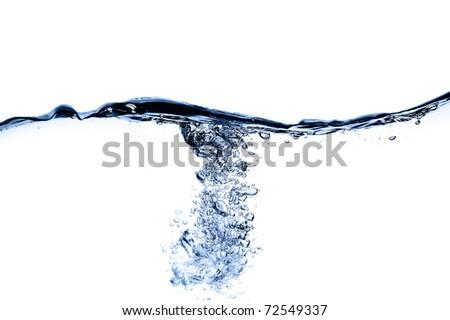 Ice cube splash into  clear liquid - stock photo