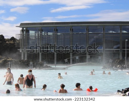 ICELAND - AUGUST 2: Visitors enjoying famous Blue Lagoon Geothermal Spa in Iceland on August 2, 2005. The Blue Lagoon geothermal spa is one of the most visited attractions in Iceland - stock photo