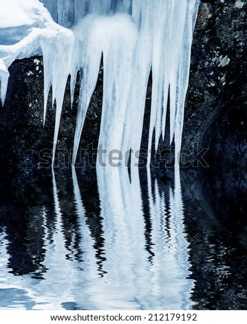 icicles on a rock - stock photo