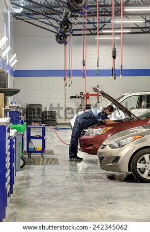 Idaho, USA Oct. 3, 2014 A mechanic working on a car in a modern automotive repair shop - stock photo
