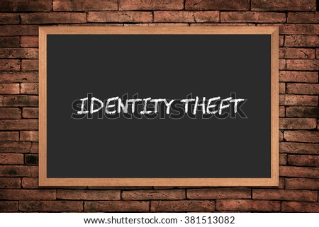 """Identity Theft"" handwritten with white chalk on a blackboard - stock photo"