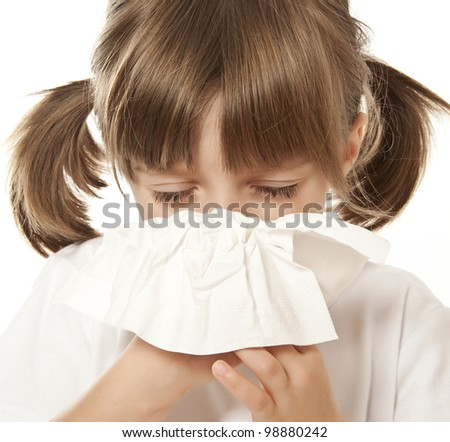 ill little girl with handkerchief - stock photo