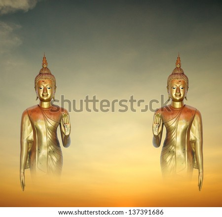Image of Buddha in Conceptual Surreal style  with cloudscape background