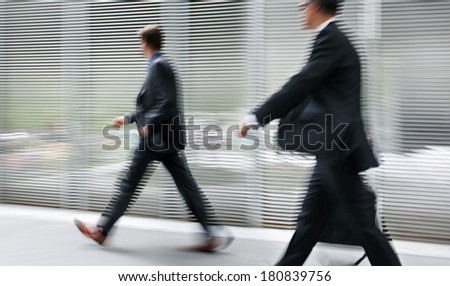 image of business people in the street and modern style with a blurred background - stock photo